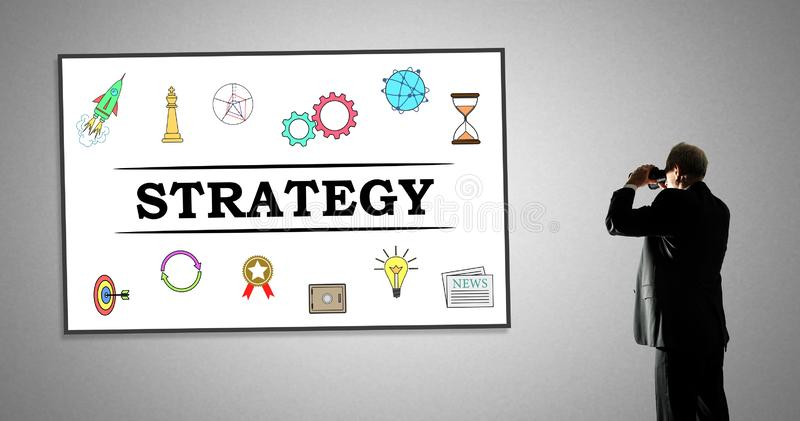 Strategy concept on a whiteboard. Man looking at strategy concept through binoculars stock photography
