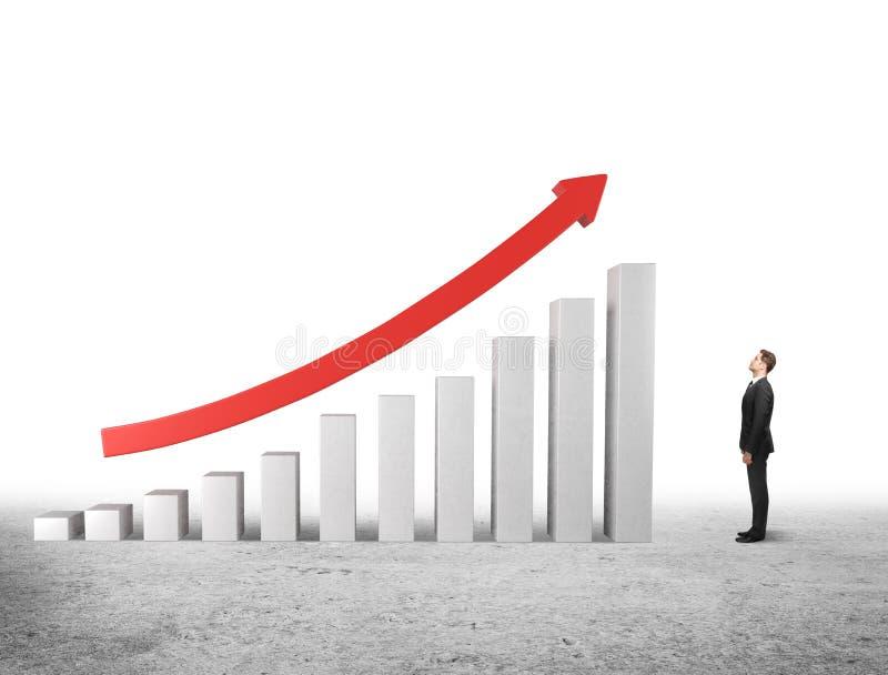 Man looking at up arrow stock photo