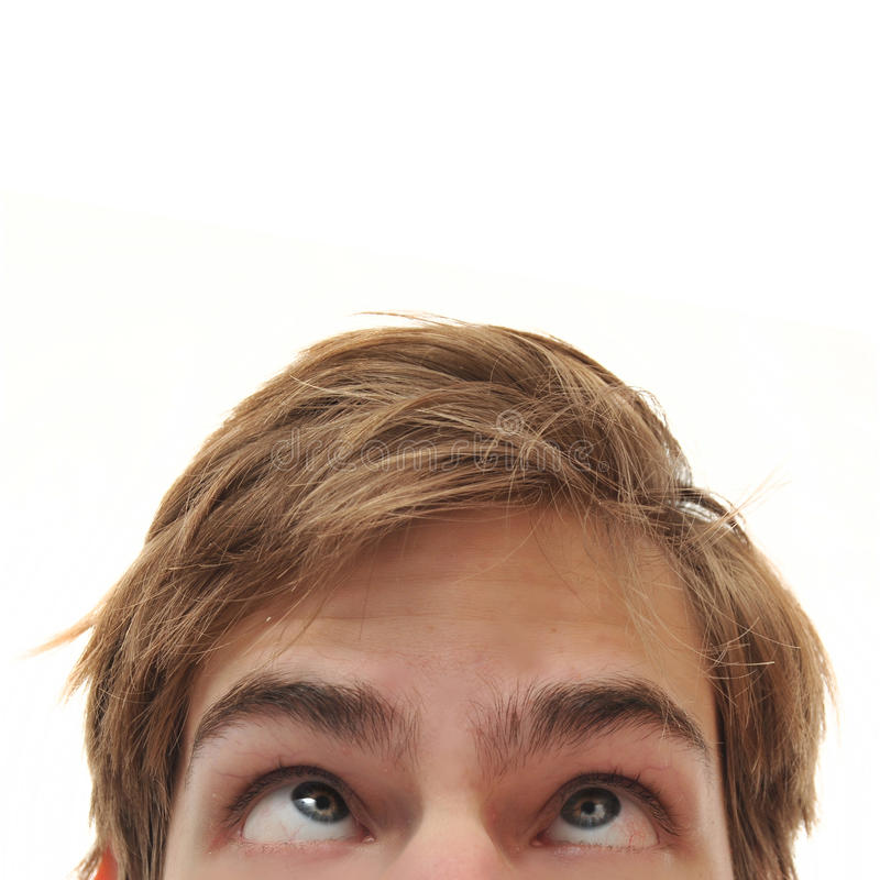 Man looking up into space. Young adult man staring up with cross eyes into empty white isolated copy space stock images
