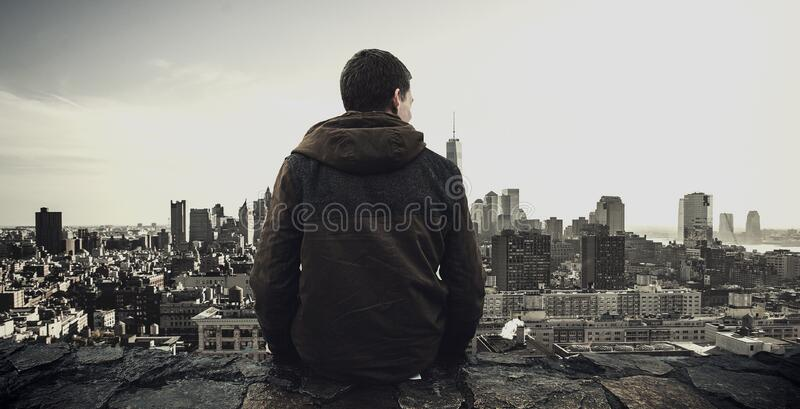 Man looking at urban skyline stock photos