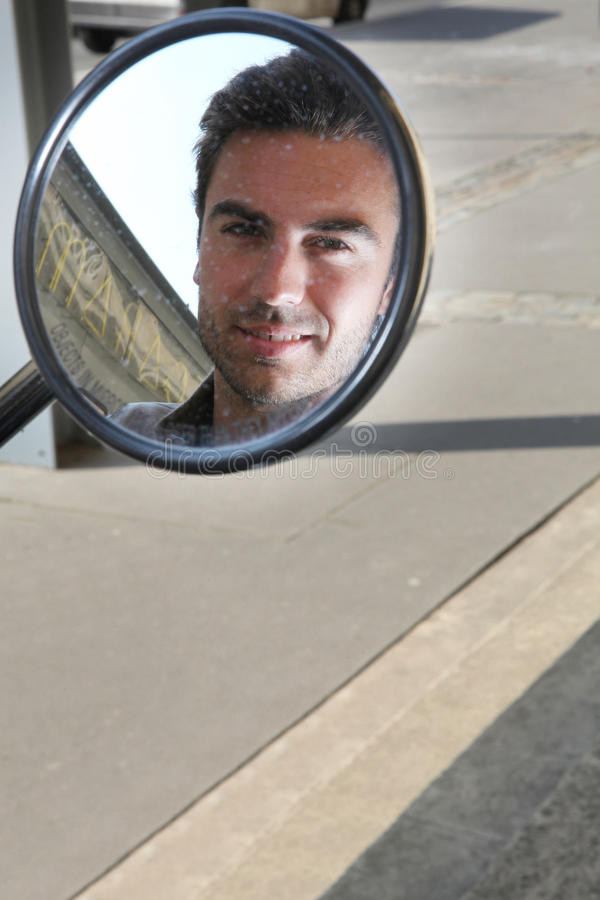 Download Man Looking In The Wing Mirror Stock Photo - Image: 25432778