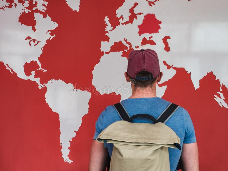 Man looking at the world map stock images