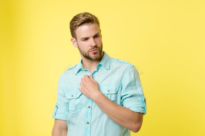 Man looks attractive casual linen blue shirt. Guy bristle undress casual shirt. Fashion concept. Man calm serious face royalty free stock photos