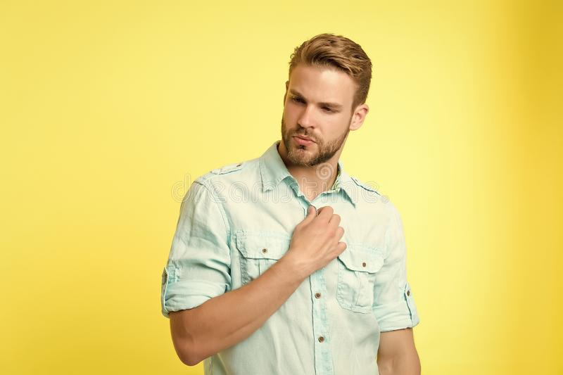 Man looks attractive casual linen blue shirt. Guy bristle undress casual shirt. Fashion concept. Man calm serious face stock image