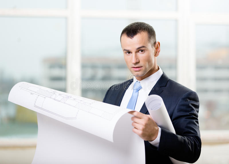 Man Looks At Blueprint In Hands Stock Photography