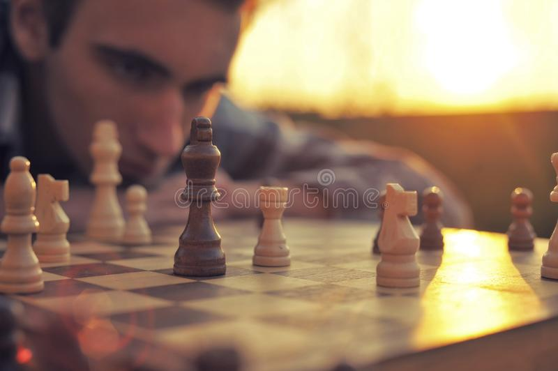 Man looks at a chessboard royalty free stock images