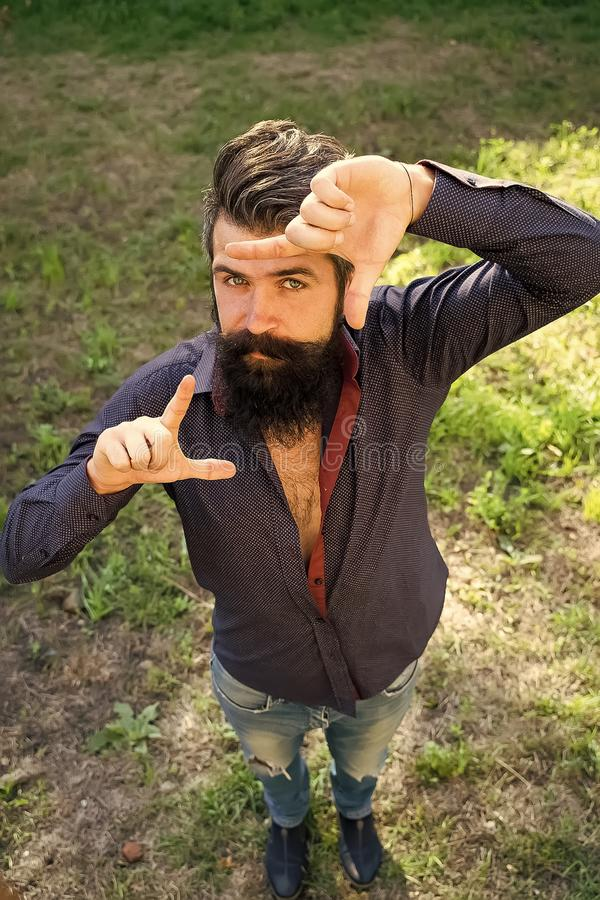 Man looks closely. Top view of man with beard. Man looks closely. Top full length view of one handsome strong stylish male logger of young man with long lush royalty free stock photos