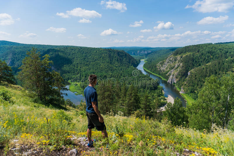 A man looks at the Panoramic view of Shulgan tash nature reserve, Bashkortostan, Russia. Aerial view royalty free stock photography