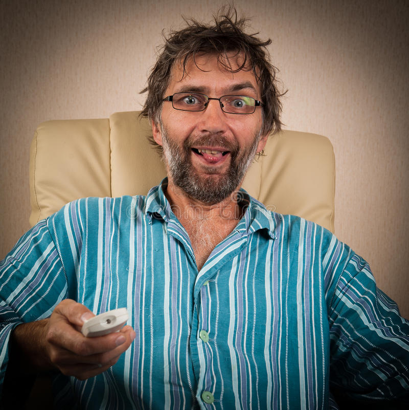Man looks piquant show on TV royalty free stock photo