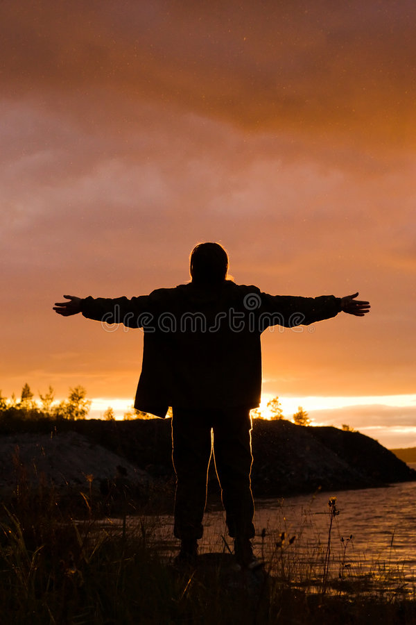 Man looks at sunset royalty free stock photo