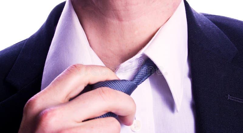 Man loosening tie stock photos