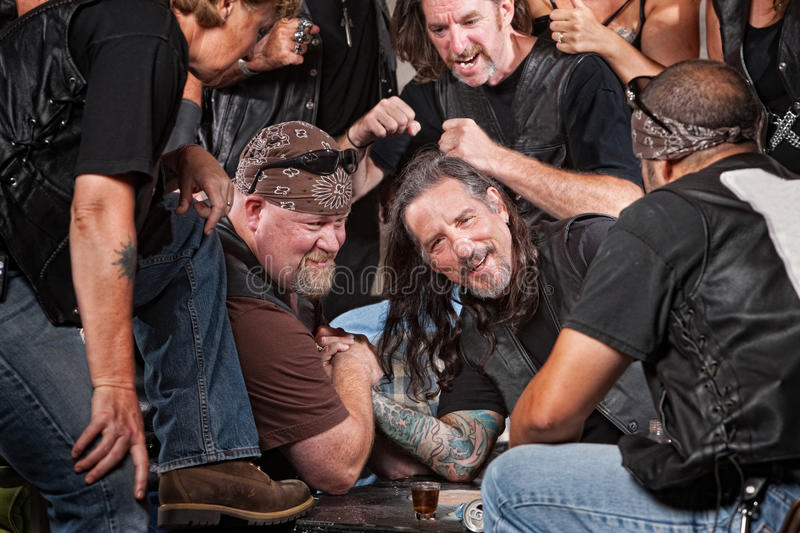 Man Loses Arm Wrestling Contest. Man loses an arm wrestling match with tough gang member stock images
