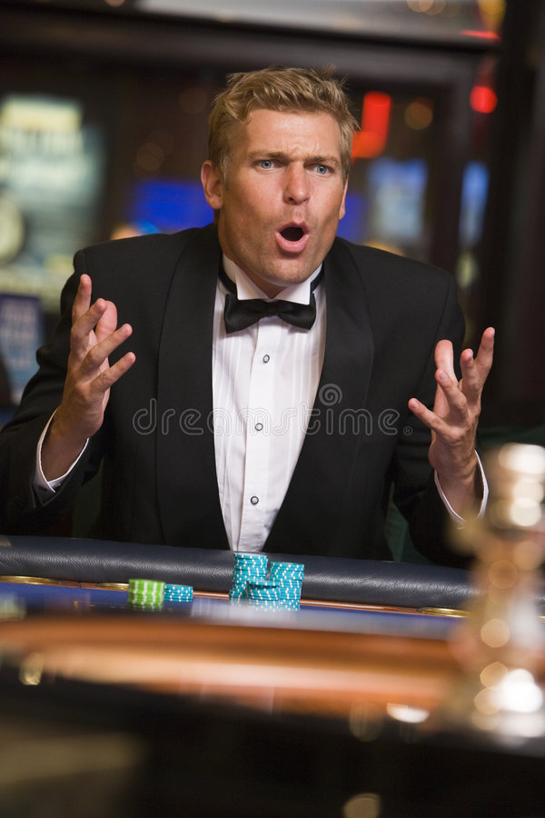 Man losing at roulette table royalty free stock photography