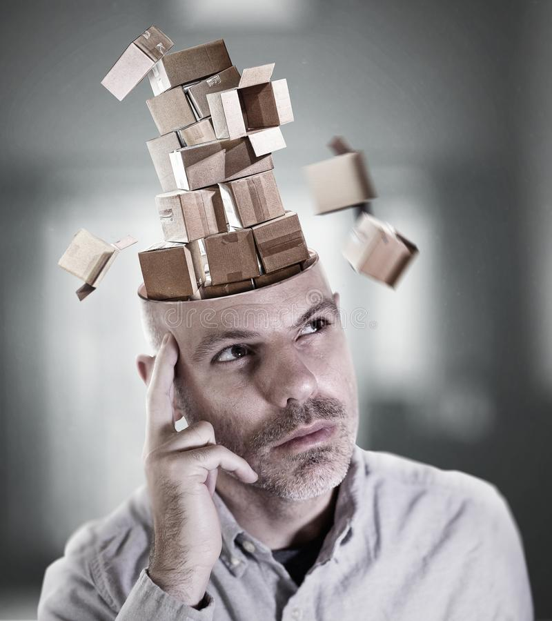 Man lost in thought. As his mind is filled with empty boxes royalty free stock photography