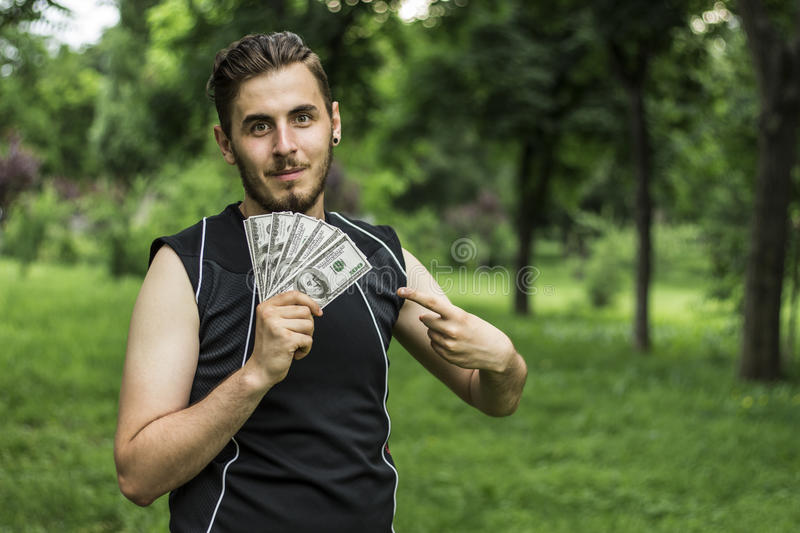 Man with a lot of dollars stock images