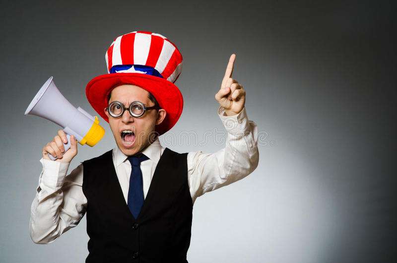 The man with loudspeaker wearing american hat. Man with loudspeaker wearing american hat royalty free stock image