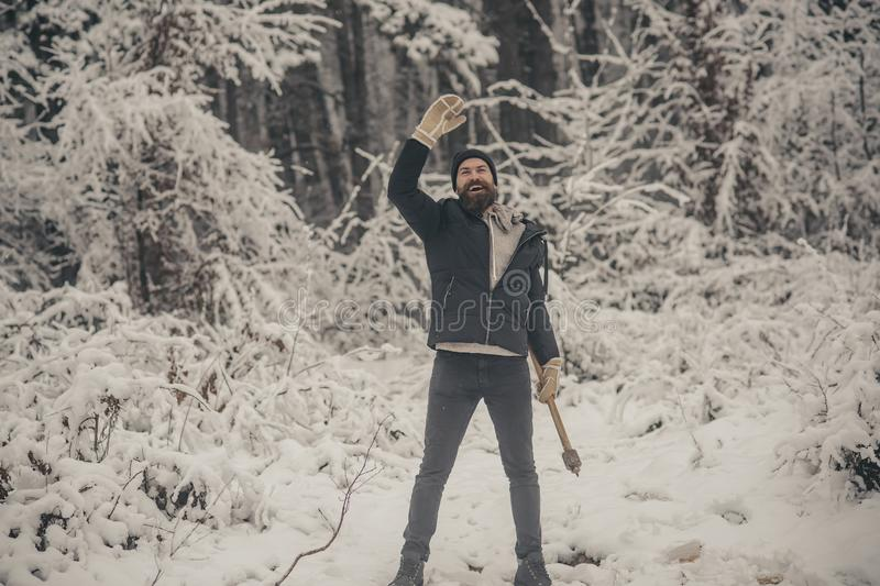 Man lumberjack in thermal jacket with ax. royalty free stock photo