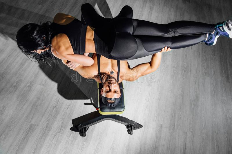 Group with dumbbell weight training equipment on sport gym. royalty free stock images
