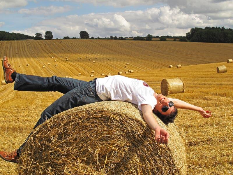 Download Man lying on hay bale stock image. Image of yellow, kingdom - 34308373