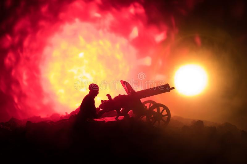Man with Machine gun at night, fire explosion background or Military silhouettes fighting scene on war fog sky background, World W. Ar Soldiers Silhouettes Below stock photos