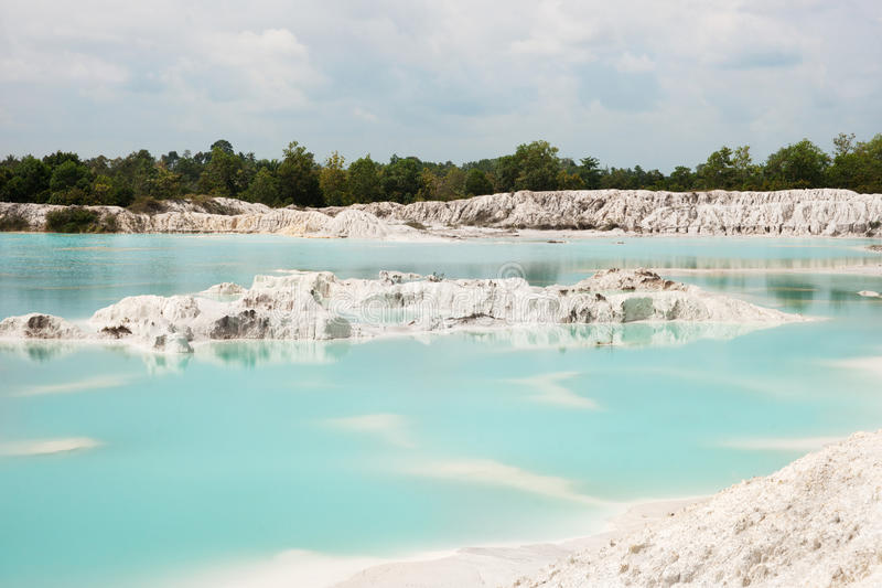 Man-made artificial clear blue lake Kaolin, mining ground holes covered by rain water. royalty free stock photos