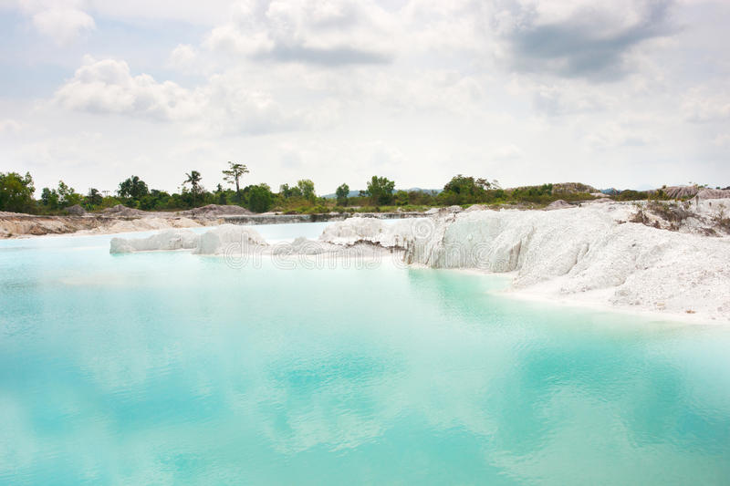 Man-made artificial lake Kaolin, turned from mining ground holes filled with rain water forming a clear blue lake, Belitung. stock photo