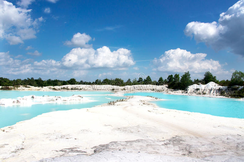 Man-made artificial lake Kaolin, turned from mining ground holes filled with rain water forming a clear blue lake, Belitung. royalty free stock image