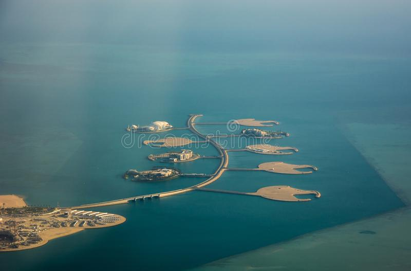 Man-made islands Isola Dana for rich villas in Pearl-Qatar of doha, Aerial view of coast of Persian Gulf stock image
