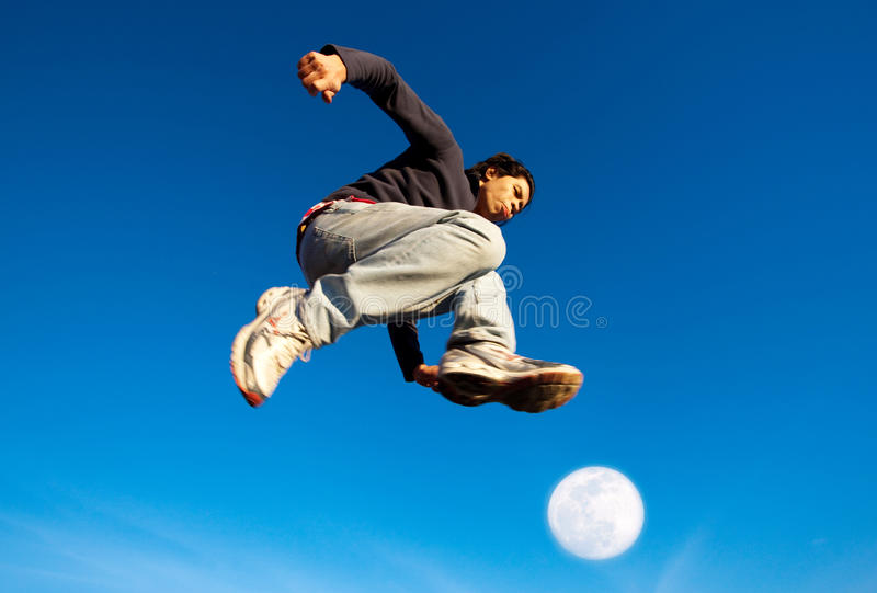 A man made a powerful high jump royalty free stock images