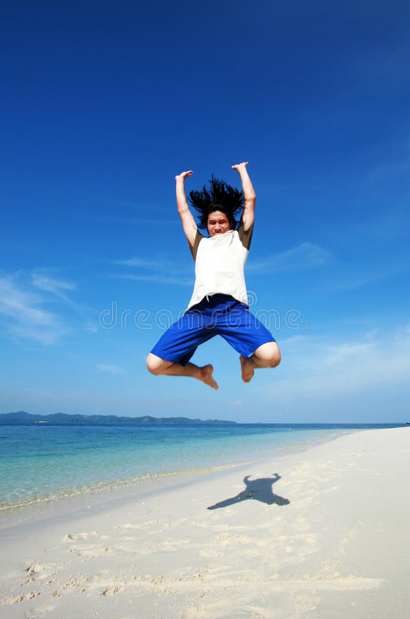 A man made a powerful high jump stock photography