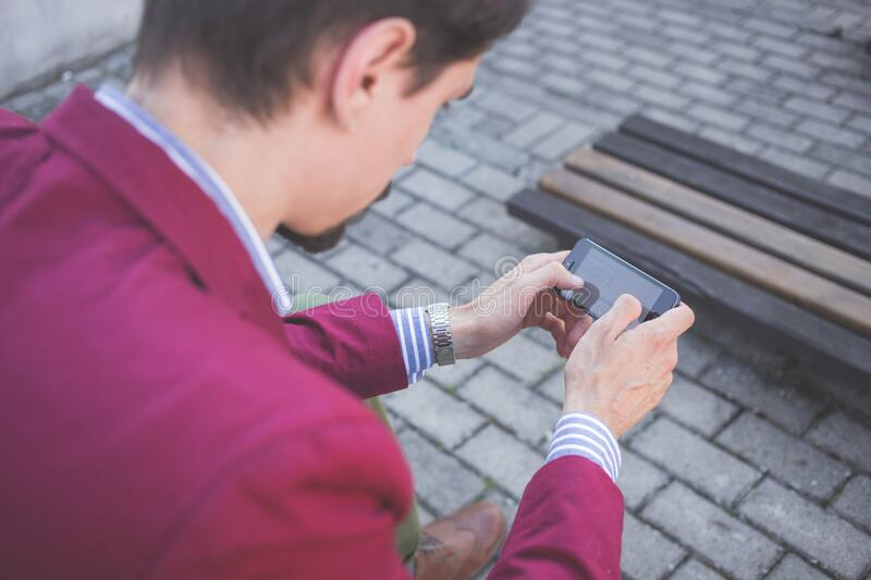 Man In Magenta Suit Jacket Holding Smartphone With Both Hands Free Public Domain Cc0 Image