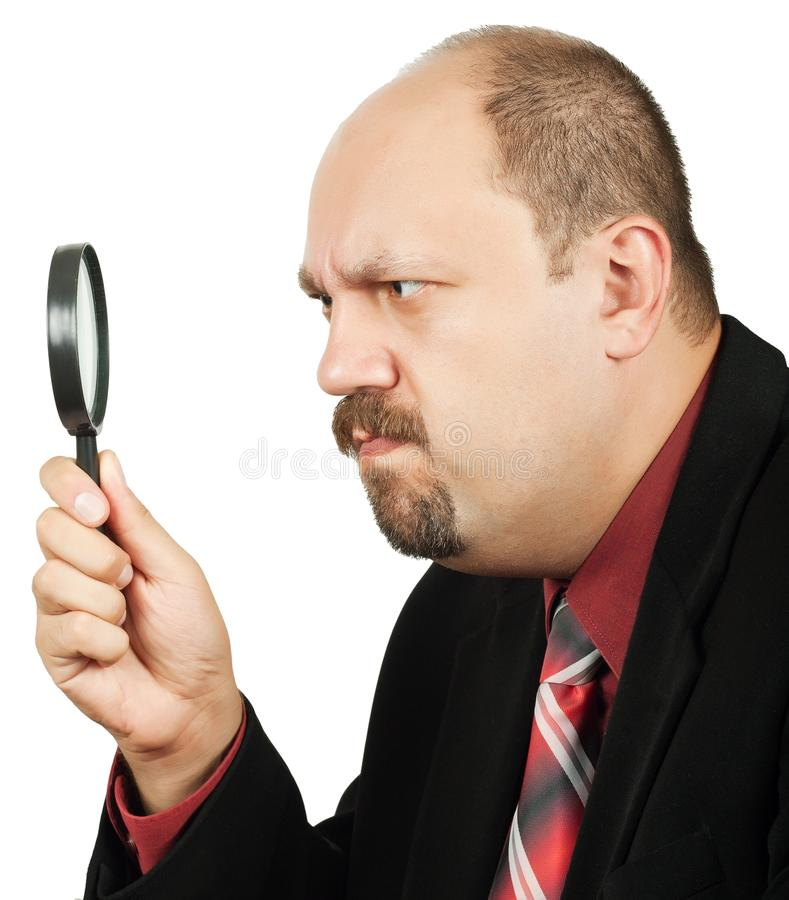 Man with magnifying glass royalty free stock images