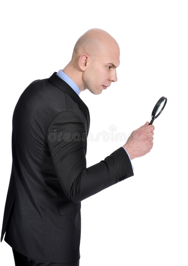 Man with Magnifying Glass searching. Man doing his own private investigation stock images