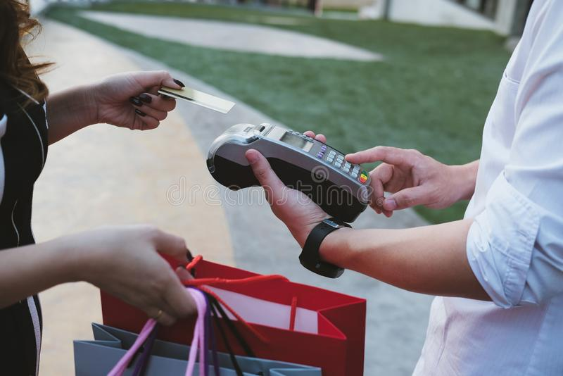Man make payment with credit card swipe through terminal. custom. Er paying & entering code with EDC or swiping machine. buy and sell product or service royalty free stock image