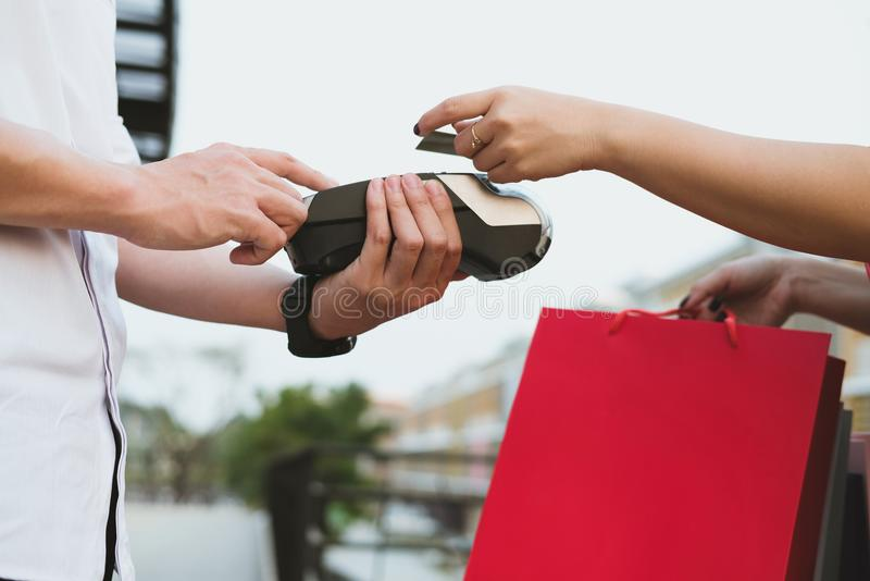 Man make payment with credit card swipe through terminal. custom. Er paying & entering code with EDC or swiping machine. buy and sell product or service stock photography