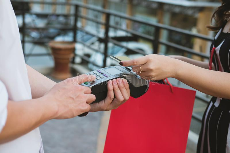 Man make payment with credit card swipe through terminal. custom. Er paying & entering code with EDC or swiping machine. buy and sell product or service stock photo