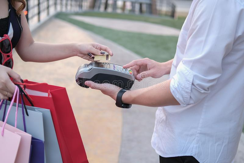 Man make payment with credit card swipe through terminal. custom. Er paying & entering code with EDC or swiping machine. buy and sell product or service royalty free stock photography