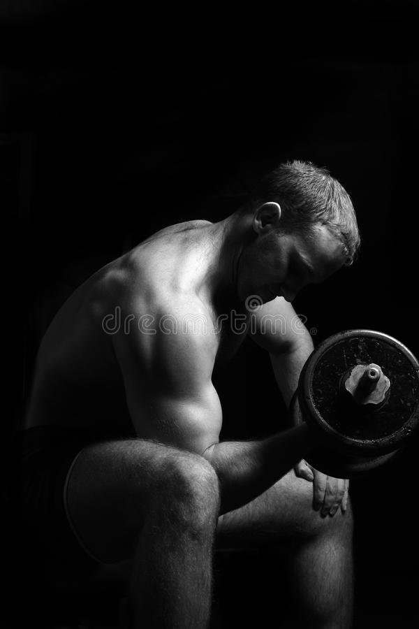 Man makes exercises with barbell. stock photography