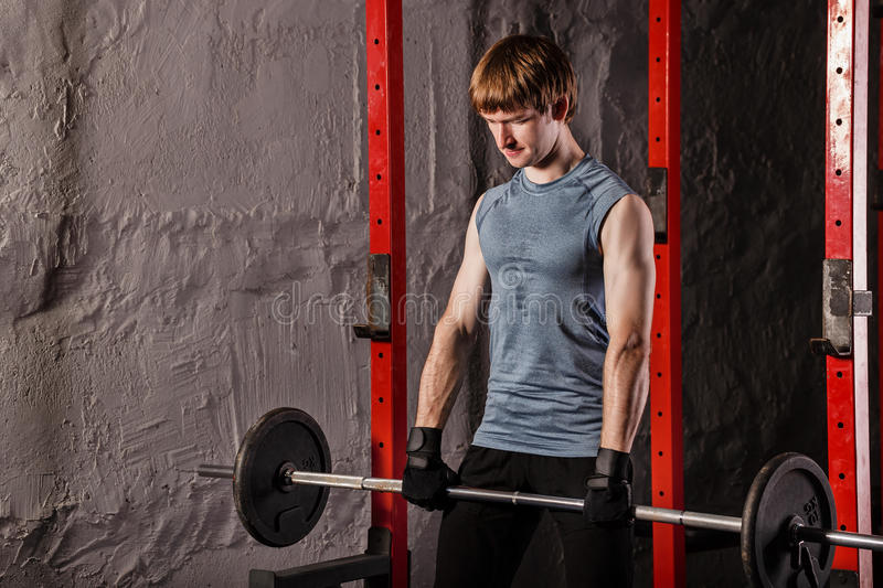Man makes exercises with a barbell. royalty free stock images