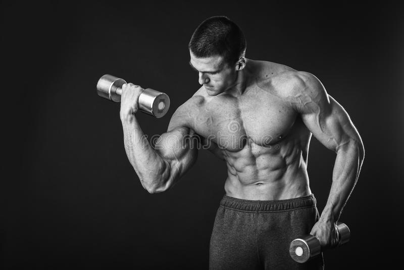 Man makes exercises dumbbells stock photography