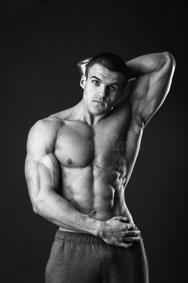 Man makes exercises dumbbells royalty free stock photography
