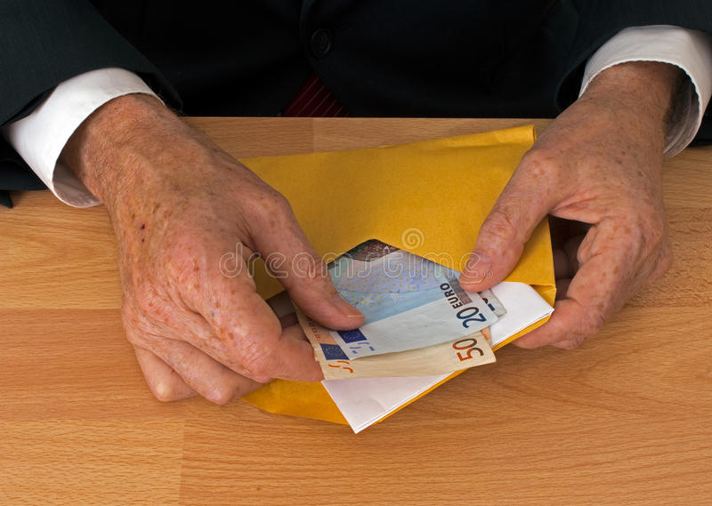 Man makes payment in Euros - with envelope royalty free stock photography