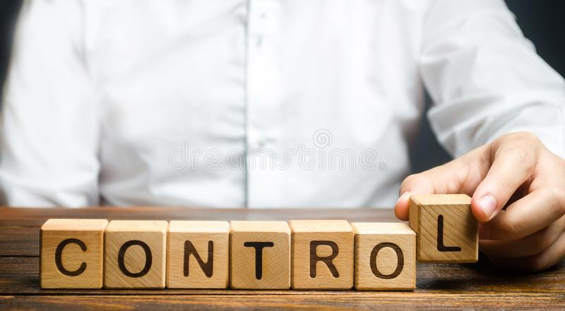 Man makes up the word Controls. Business and process management concept. Control Monitoring compliance with rules. And responsibilities. Manage staff and royalty free stock image