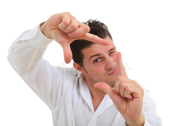 Man making frame with his fingers stock photography