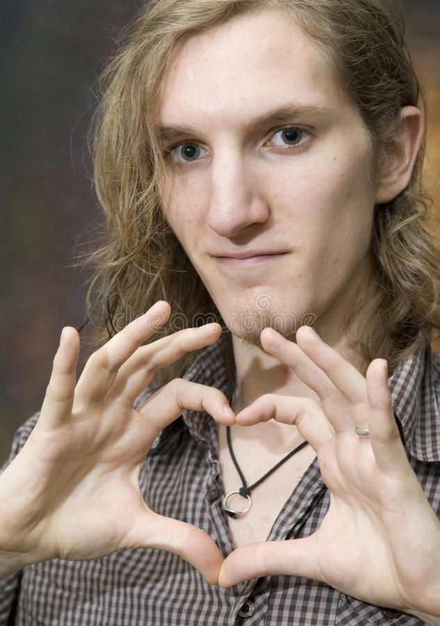 Download Man Making Heart Shape With Hands Stock Photo - Image: 20549314