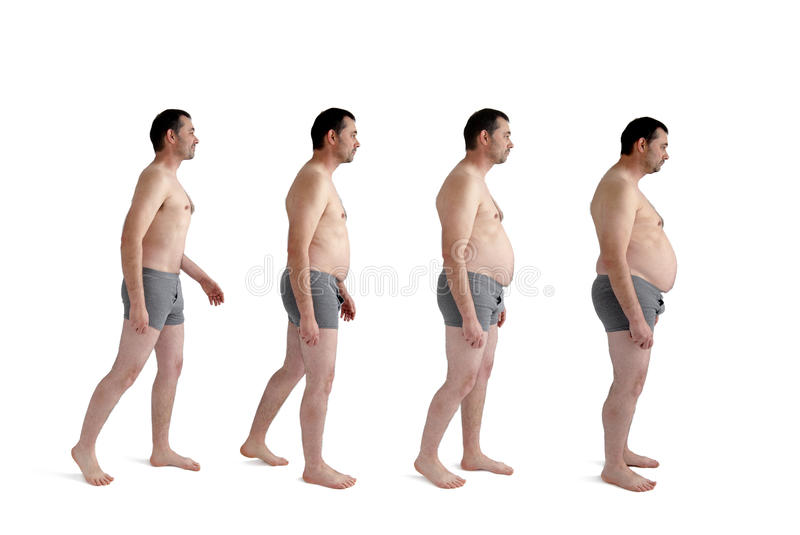 Man making incremental weight gain royalty free stock image