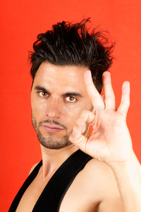 Download Man making ok gesture stock photo. Image of shot, pose - 25973180