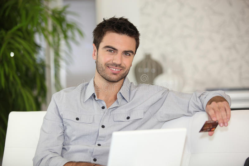 Man making online purchase. Man paying for an online purchase royalty free stock photos