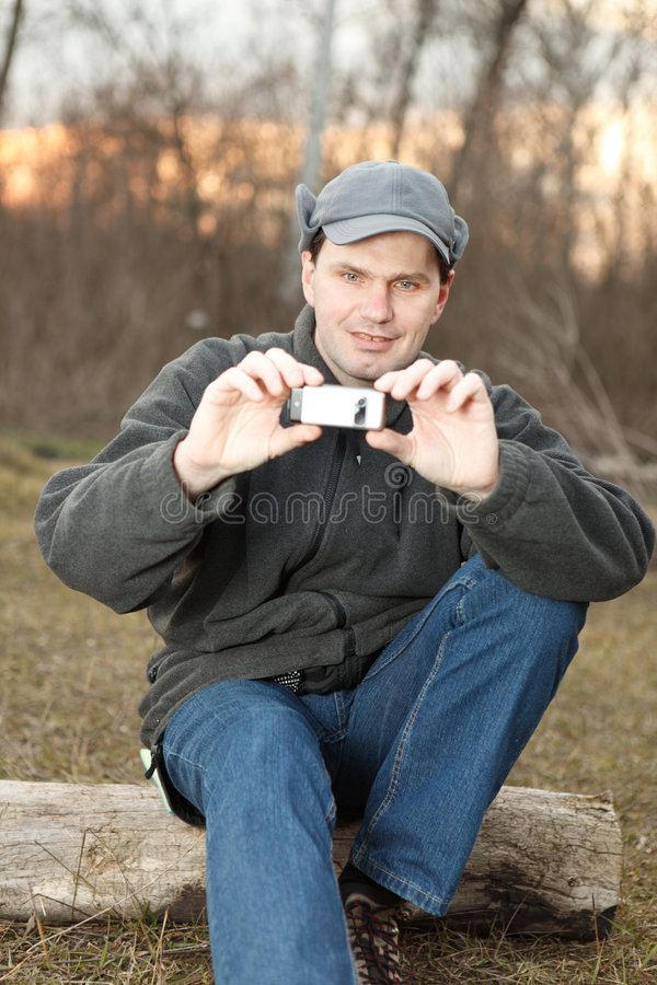 Man making photo with mobile phone royalty free stock photo