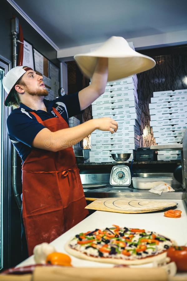 Man Making Pizza Dough stock photography